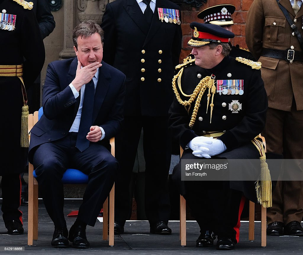 Prime Minister David Cameron (L) speaks with a military officer as he watches the main military parade during the Armed Forces Day National Event on June 25, 2016 in Cleethorpes, England. The visit by the Prime Minister came the day after the country voted to leave the European Union. Armed Forces Day is an annual event that gives an opportunity for the country to show its support for the men and women in the British Armed Forces.