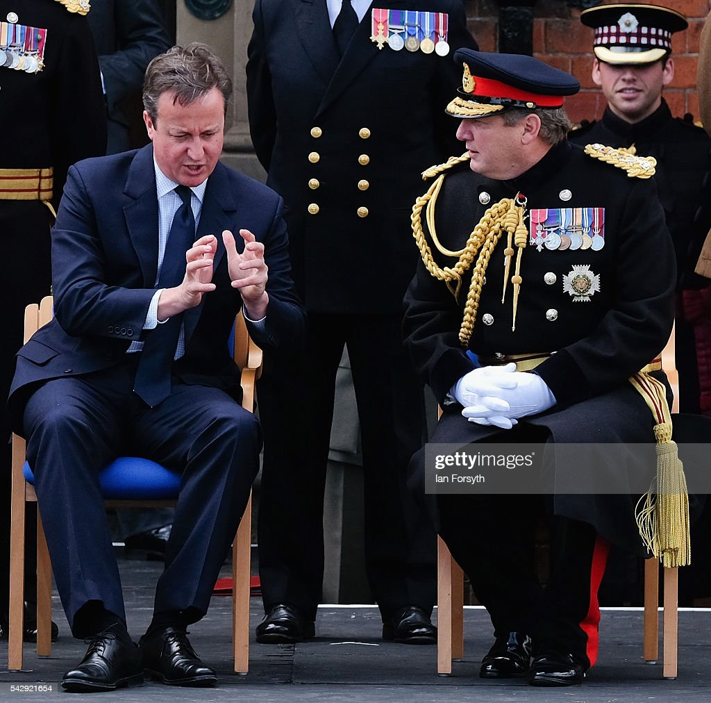 Prime Minister David Cameron speaks with General Sir Chris Deverell, Commander of Joint Forces Command during the main military parade at the Armed Forces Day National Event on June 25, 2016 in Cleethorpes, England. The visit by the Prime Minister came the day after the country voted to leave the European Union. Armed Forces Day is an annual event that gives an opportunity for the country to show its support for the men and women in the British Armed Forces.