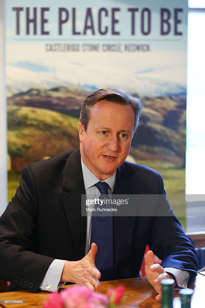 Prime Minister <a gi-track='captionPersonalityLinkClicked' href=/galleries/search?phrase=David+Cameron+-+Pol%C3%ADtico&family=editorial&specificpeople=227076 ng-click='$event.stopPropagation()'>David Cameron</a> speaks with members of the Lake District National Park Partnership Business Task Force at Allan Bank House on January 28, 2016 in Grasmere, England. The Prime Minister announced a £2million support package to boost tourism and encourage British families to visit the region over the Easter break. The money will also be spent on repairing the flood-damaged infrastructure across the North of England and the Lake District National Park.
