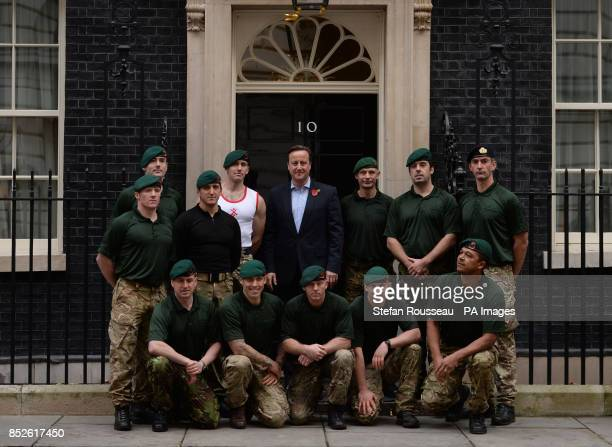Prime Minister David Cameron stands with a team of serving Royal Marineacircs Charity Speedmarchers in Downing Street central London after they...