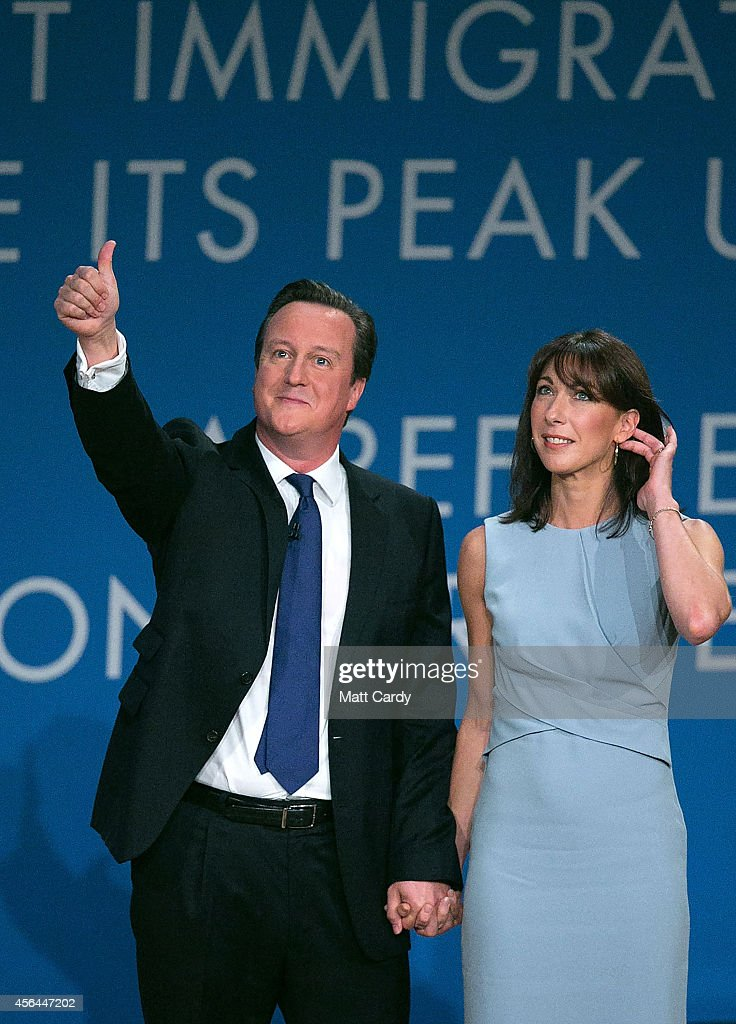 Prime Minister David Cameron stands with his wife Samantha after giving his keynote speech to the Conservative party conference on October 1 2014 in...