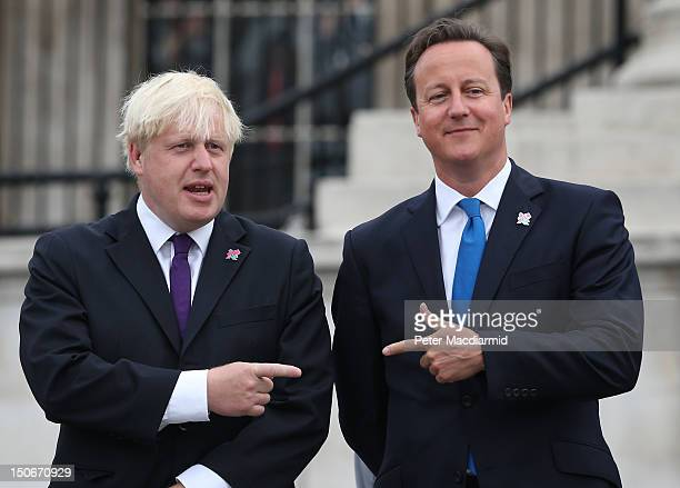 Prime Minister David Cameron stands with London Mayor Boris Johnson as the Olympic cauldron is lit for the Paralympic Games in Trafalgar Square on...