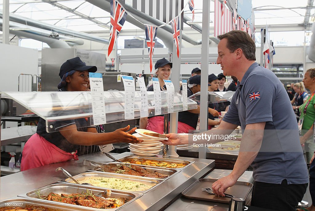 Prime Minister David Cameron takes lunch with Team GB athletes during a visit to the Olympic Village on Day 14 of the London 2012 Olympic Games on...