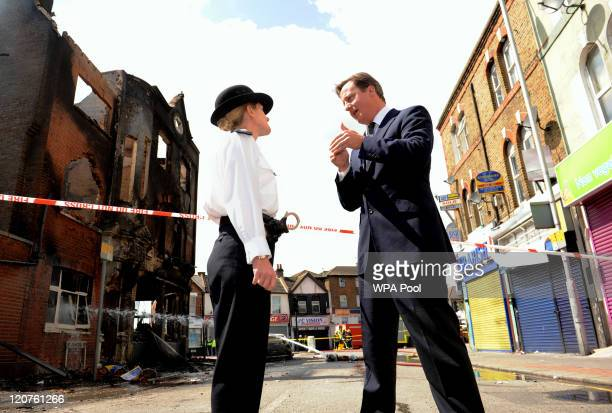 Prime Minister David Cameron talks to Acting Borough Commander Superintendent Jo Oakley during a visit to Croydon to view the destruction from the...