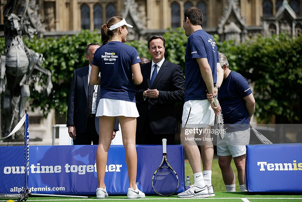 Prime Minister David Cameron talks to former British Number 1 tennis player Greg Rusedski and British Number 3 female Johanna Konta, at the LTA's #TennisIS event in the grounds of the Houses of Parliament on June 19, 2013 in London, England. The event is part of a programme of activity to promote tennis as a sport for all ages and abilities, at a time when it takes centre stage for the British public on the eve of The Championships, Wimbledon.