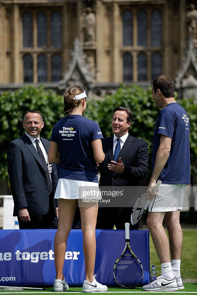 Prime Minister <a gi-track='captionPersonalityLinkClicked' href=/galleries/search?phrase=David+Cameron+-+Politician&family=editorial&specificpeople=227076 ng-click='$event.stopPropagation()'>David Cameron</a> talks to former British Number 1 tennis player Greg Rusedski and British Number 3 female Johanna Konta, at the LTA's #TennisIS event in the grounds of the Houses of Parliament on June 19, 2013 in London, England. The event is part of a programme of activity to promote tennis as a sport for all ages and abilities, at a time when it takes centre stage for the British public on the eve of The Championships, Wimbledon.