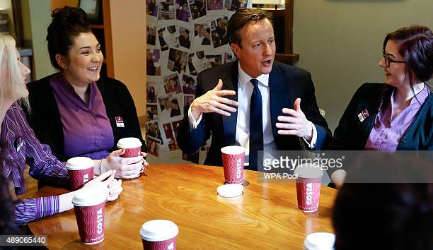 Prime Minister David Cameron talks to Whitbread apprentices during a visit to a Premier Inn hotel on April 9 2015 in Leeds England Britain goes to...