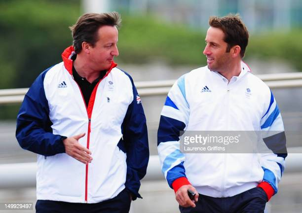 Prime Minister David Cameron talks with Finn class gold medallist Ben Ainslie in the competition boat yard on Day 11 of the London 2012 Olympic Games...