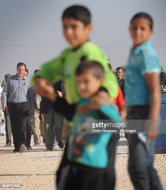 Prime Minister David Cameron tours the Za'atri refugee camp near the Syrian Jordanian border where he met Syrian families who have escaped across the...