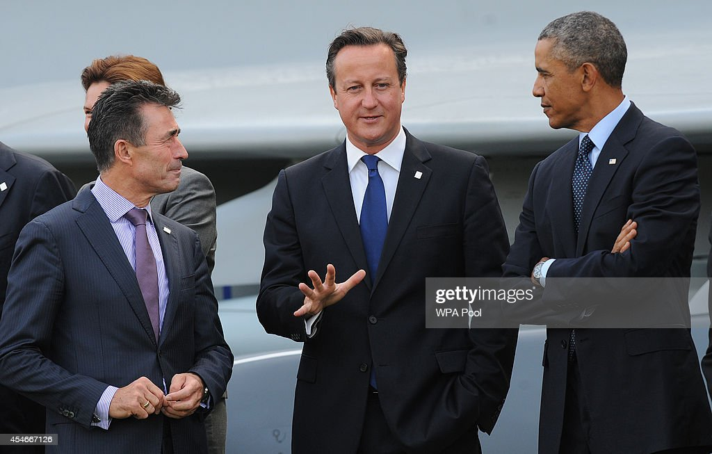 Prime Minister <a gi-track='captionPersonalityLinkClicked' href=/galleries/search?phrase=David+Cameron+-+Pol%C3%ADtico&family=editorial&specificpeople=227076 ng-click='$event.stopPropagation()'>David Cameron</a> (centre), US Prsident <a gi-track='captionPersonalityLinkClicked' href=/galleries/search?phrase=Barack+Obama&family=editorial&specificpeople=203260 ng-click='$event.stopPropagation()'>Barack Obama</a> and Nato Secretary General <a gi-track='captionPersonalityLinkClicked' href=/galleries/search?phrase=Anders+Fogh+Rasmussen&family=editorial&specificpeople=549374 ng-click='$event.stopPropagation()'>Anders Fogh Rasmussen</a> and other Nato leaders gather to watch a flypast of military aircraft from Nato member countries on the final day of the summit at the Celtic Manor Resort on September 5, 2014 in Newport, United Kingdom. Leaders and senior ministers from around 60 countries are meeting on the final day of the two day summit with Afghanistan and Ukraine at the top of the agenda.