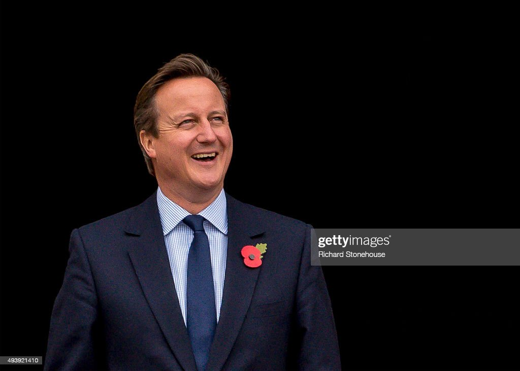 Prime Minister <a gi-track='captionPersonalityLinkClicked' href=/galleries/search?phrase=David+Cameron+-+Pol%C3%ADtico&family=editorial&specificpeople=227076 ng-click='$event.stopPropagation()'>David Cameron</a> waits for President Xi Jinping to arrive for lunch at Manchester Town Hall on October 23, 2015 in Manchester, England. After listening to a presentation from Dame Nancy Rothwell, the party toured the University Centre which leads the world in graphene research and is one of the most important centres for commercialising the one-atom-thick material.