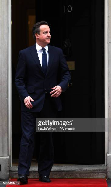 Prime Minister David Cameron waits to greet The Amir of the State of Kuwait His Highness Sheikh Sabah AlAhmad Aljaber AlSabah outside 10 Downing St...