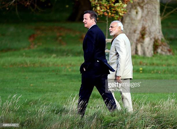 Prime Minister David Cameron walks in the garden at Chequers in Buckinghamshire with his Indian counterpart Narendra Modi on the second day of an...
