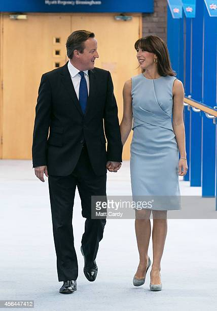 Prime Minister David Cameron walks with his wife Samantha to deliver his keynote speech to the Conservative party conference on October 1 2014 in...