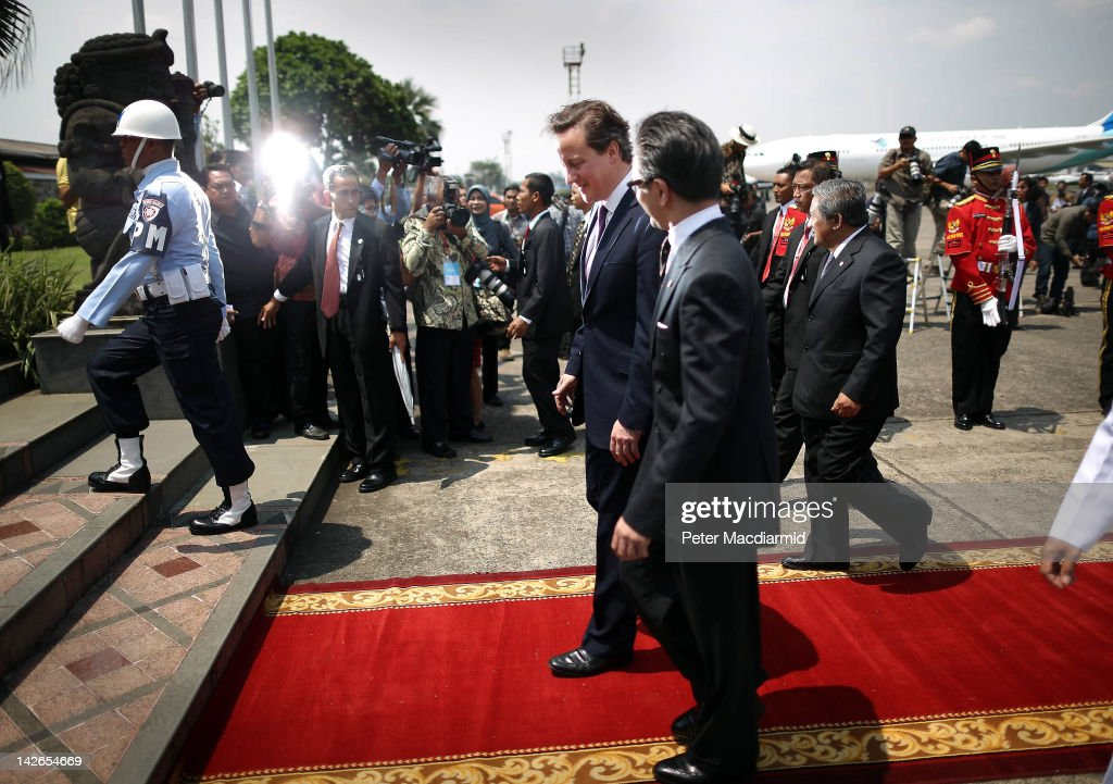 Prime Minister <a gi-track='captionPersonalityLinkClicked' href=/galleries/search?phrase=David+Cameron+-+Politician&family=editorial&specificpeople=227076 ng-click='$event.stopPropagation()'>David Cameron</a> (C) walks with Indonesian Minister of Foreign Affairs <a gi-track='captionPersonalityLinkClicked' href=/galleries/search?phrase=Marty+Natalegawa&family=editorial&specificpeople=2862416 ng-click='$event.stopPropagation()'>Marty Natalegawa</a> as he arrives at Halim airport on April 11, 2012 in Jakarta, Indonesia. Mr Cameron is on a five day visit to the Far East.