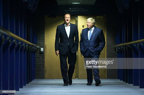 Prime Minister David Cameron walks with Mayor of London and Parliamentary candidate Boris Johnson at the Conservative party conference on September...