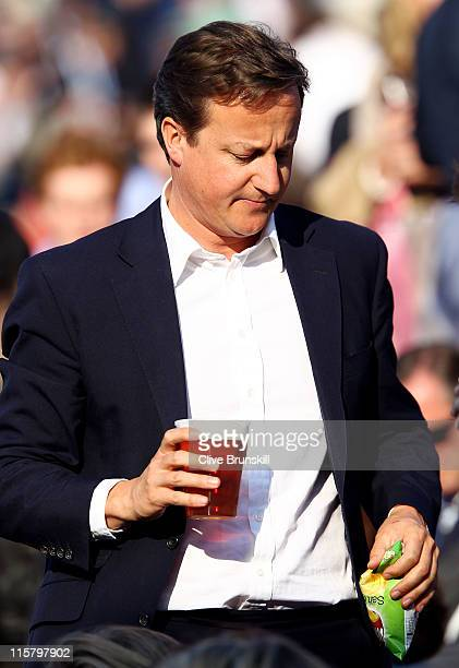 Prime Minister David Cameron watches the Men's Singles quarter final match between JoWilfred Tsonga of France and Rafael Nadal of Spain on day five...