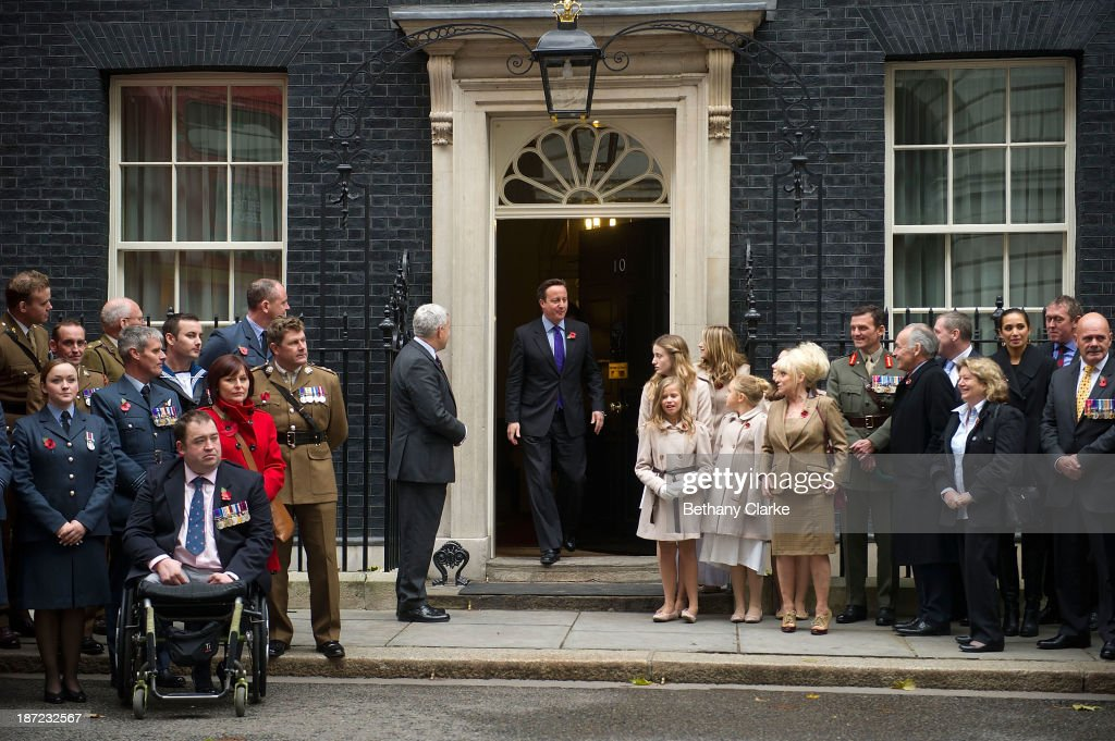 Prime Minister, <a gi-track='captionPersonalityLinkClicked' href=/galleries/search?phrase=David+Cameron+-+Politician&family=editorial&specificpeople=227076 ng-click='$event.stopPropagation()'>David Cameron</a> welcomes The Poppy Girls to perform their appeal single at Downing Street on November 7, 2013 in London, England. Prime Minister <a gi-track='captionPersonalityLinkClicked' href=/galleries/search?phrase=David+Cameron+-+Politician&family=editorial&specificpeople=227076 ng-click='$event.stopPropagation()'>David Cameron</a> welcomes a Poppy Bus and The Poppy Girls to Downing Street to support the Royal British Legion's Poppy Appeal.