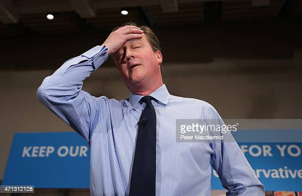Prime Minister David Cameron wipes away some sweat as he speaks to business leaders on April 27 2015 in London England Mr Cameron has started the...