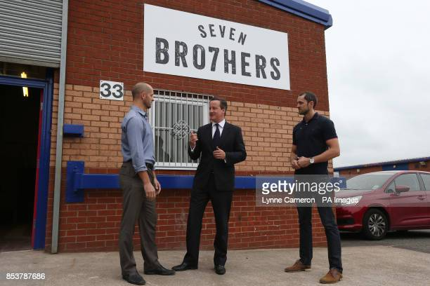 Prime Minister David Cameron with Keith and Kit McAvoy during his visit to a small business start up Seven Bro7hers brewery in Salford