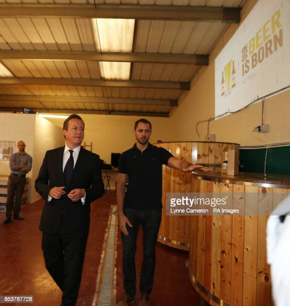 Prime Minister David Cameron with Kit McAvoy during his visit to a small business start up Seven Bro7hers brewery in Salford