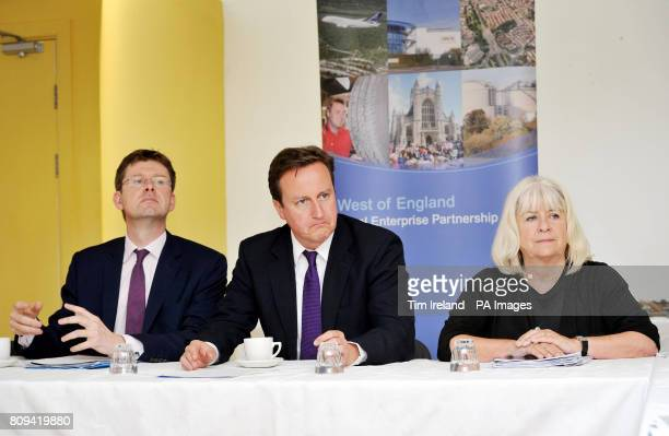 Prime Minister David Cameron with Minister for Cities Greg Clark and Bristol City Council leader Barbara Janke during a meeting at Paintworks in...