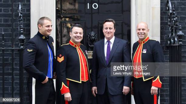 Prime Minister David Cameron with The Soldiers Lance Corporal Ryan Idzi Staff Sergeant Richie Maddocks and Sergeant Major Gary Chiltern on the steps...