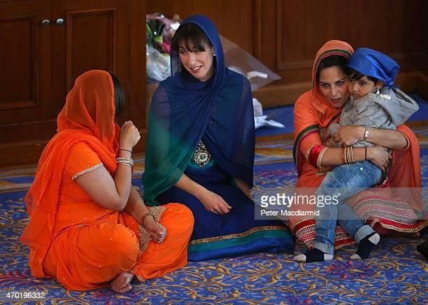 Prime Minister David Cameron's wife Samantha sits with Parliamentary candidate Priti Patel in the Guru Nanak Darbar Gurdwara during the Vaisakhi...
