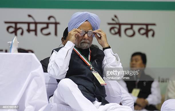 Prime Minister Dr Manmohan Singh during All India Congress Committee meet at Talkatora stadium on January 17 2014 in New Delhi India Rahul Gandhi...