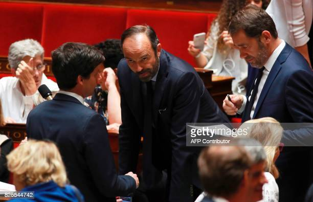 Prime Minister Edouard Philippe flanked by Minister of State for Relations with Parliament and government spokesperson Christophe Castaner looks on...