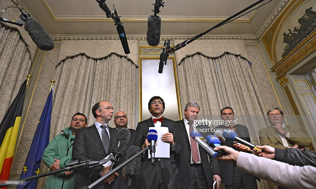 Prime Minister Elio Di Rupo (C), flanked by participants of the meetings, among which Walloon Minister President Rudy Demotte (CL) and Walloon Minister of Economy Jean-Claude Marcourt (2ndR) addresses the press after a meeting between the Federal Government, the Walloon Government and the ArcelorMittal unions, on January 25, 2013 at the Prime Minister's residence, in Brussels. Yesterday steelmaker ArcelorMittal announced the closure of the cold lines in Liege. 1300 jobs are threatened. BELGA