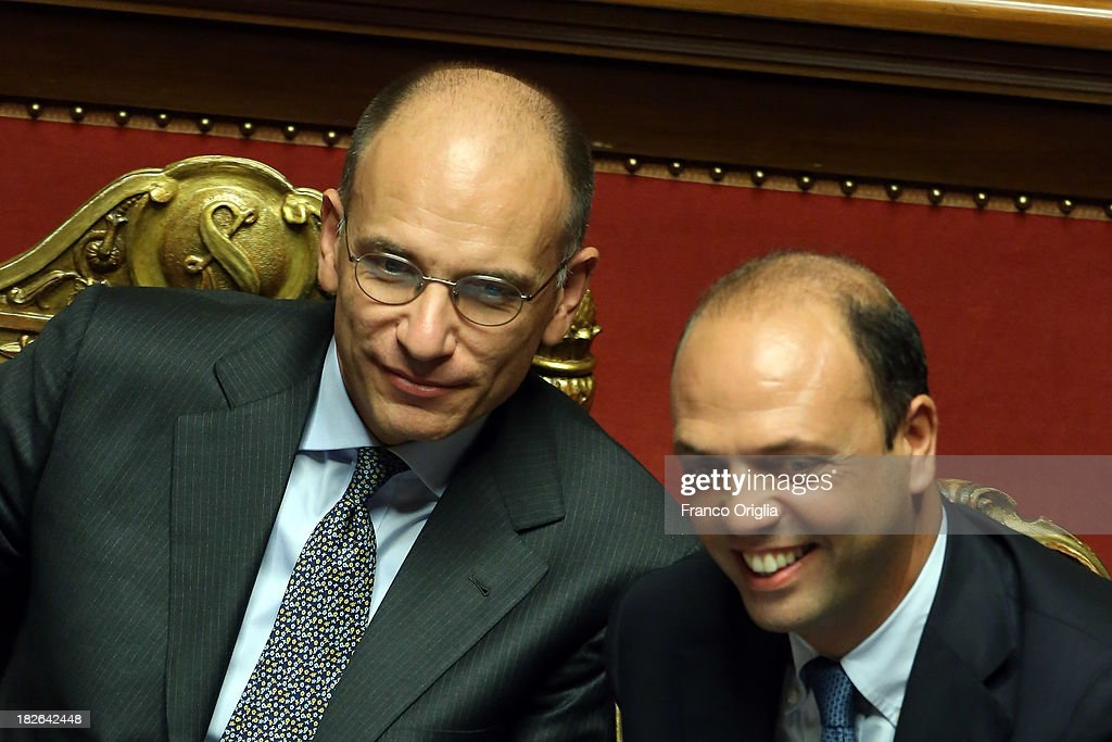 Prime Minister <a gi-track='captionPersonalityLinkClicked' href=/galleries/search?phrase=Enrico+Letta&family=editorial&specificpeople=2915592 ng-click='$event.stopPropagation()'>Enrico Letta</a> and Deputy Prime Minister and Interior Minister <a gi-track='captionPersonalityLinkClicked' href=/galleries/search?phrase=Angelino+Alfano&family=editorial&specificpeople=5101299 ng-click='$event.stopPropagation()'>Angelino Alfano</a>(R) smile after gaining the confidence vote for their government at the Italian Senate, Palazzo Madama on October 2, 2013 in Rome, Italy. After asking all his ministers to resign, Silvio Berlusconi changed his mind and voted in support of the government as Prime Minister <a gi-track='captionPersonalityLinkClicked' href=/galleries/search?phrase=Enrico+Letta&family=editorial&specificpeople=2915592 ng-click='$event.stopPropagation()'>Enrico Letta</a> gained the confidence vote at the Italian Senate with 235 consents out of 321 seats.