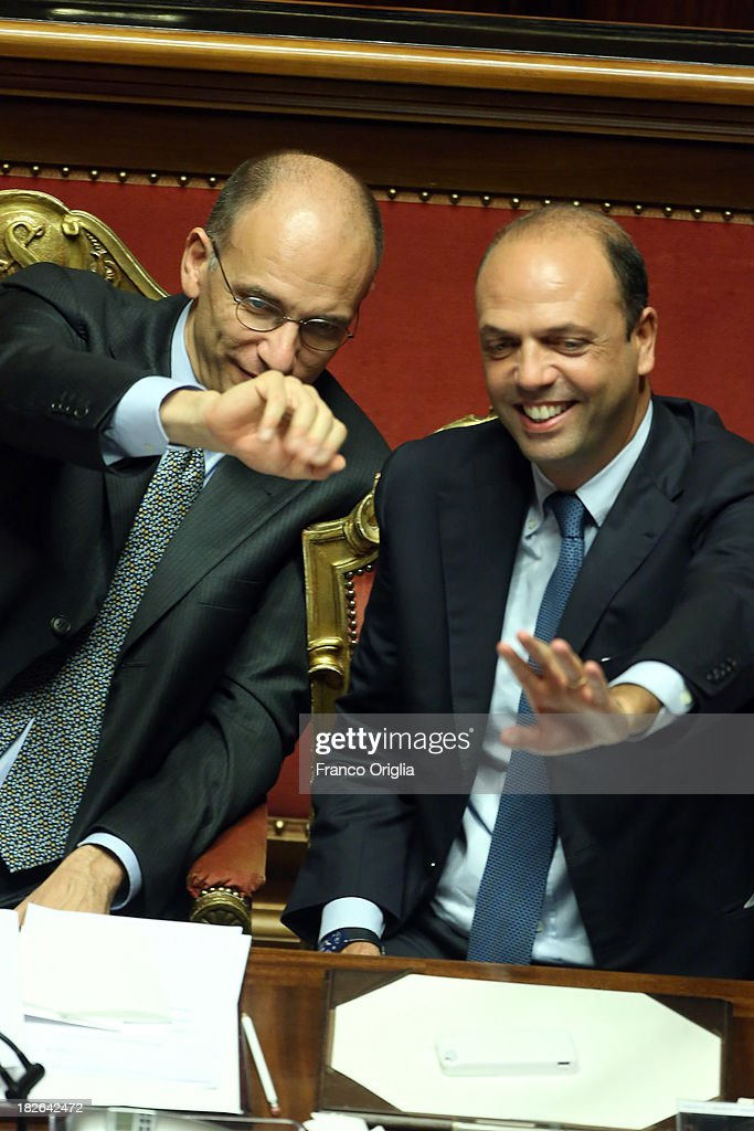 Prime Minister <a gi-track='captionPersonalityLinkClicked' href=/galleries/search?phrase=Enrico+Letta&family=editorial&specificpeople=2915592 ng-click='$event.stopPropagation()'>Enrico Letta</a> and Deputy Prime Minister and Interior Minister <a gi-track='captionPersonalityLinkClicked' href=/galleries/search?phrase=Angelino+Alfano&family=editorial&specificpeople=5101299 ng-click='$event.stopPropagation()'>Angelino Alfano</a>(R) smile and wave after gaining the confidence vote for their government at the Italian Senate, Palazzo Madama on October 2, 2013 in Rome, Italy. After asking all his ministers to resign, Silvio Berlusconi changed his mind and voted in support of the government as Prime Minister <a gi-track='captionPersonalityLinkClicked' href=/galleries/search?phrase=Enrico+Letta&family=editorial&specificpeople=2915592 ng-click='$event.stopPropagation()'>Enrico Letta</a> gained the confidence vote at the Italian Senate with 235 consents out of 321 seats.