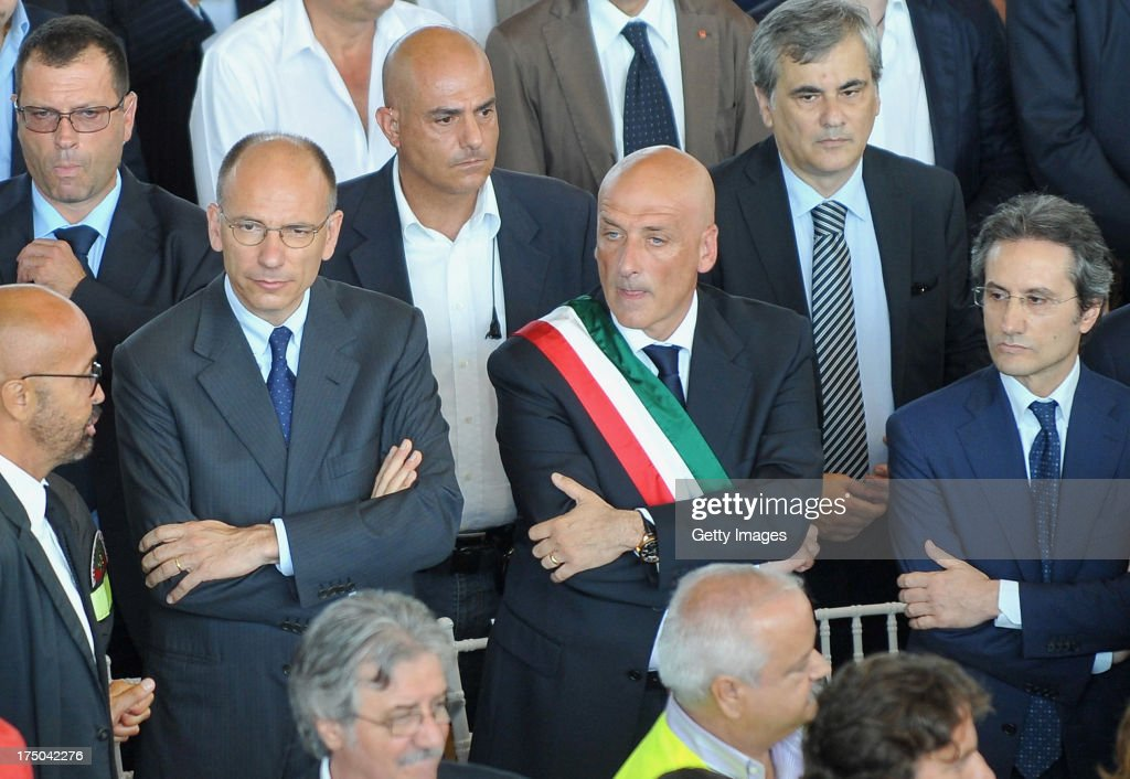 Prime Minister <a gi-track='captionPersonalityLinkClicked' href=/galleries/search?phrase=Enrico+Letta&family=editorial&specificpeople=2915592 ng-click='$event.stopPropagation()'>Enrico Letta</a>, Mayor of Pozzuoli Vincenzo Figliolia and President of Campania Region Stefano Caldoro attend the funeral of the victims of the Monteforte Irpino coach crash held at a local indoor sports arena on July 30, 2013 in Pozzuoli, Italy. In the second major European transport disaster in a week, 39 people were killed when a coach bus fell from a viaduct near Monteforte Irpino, Italy on July 28.