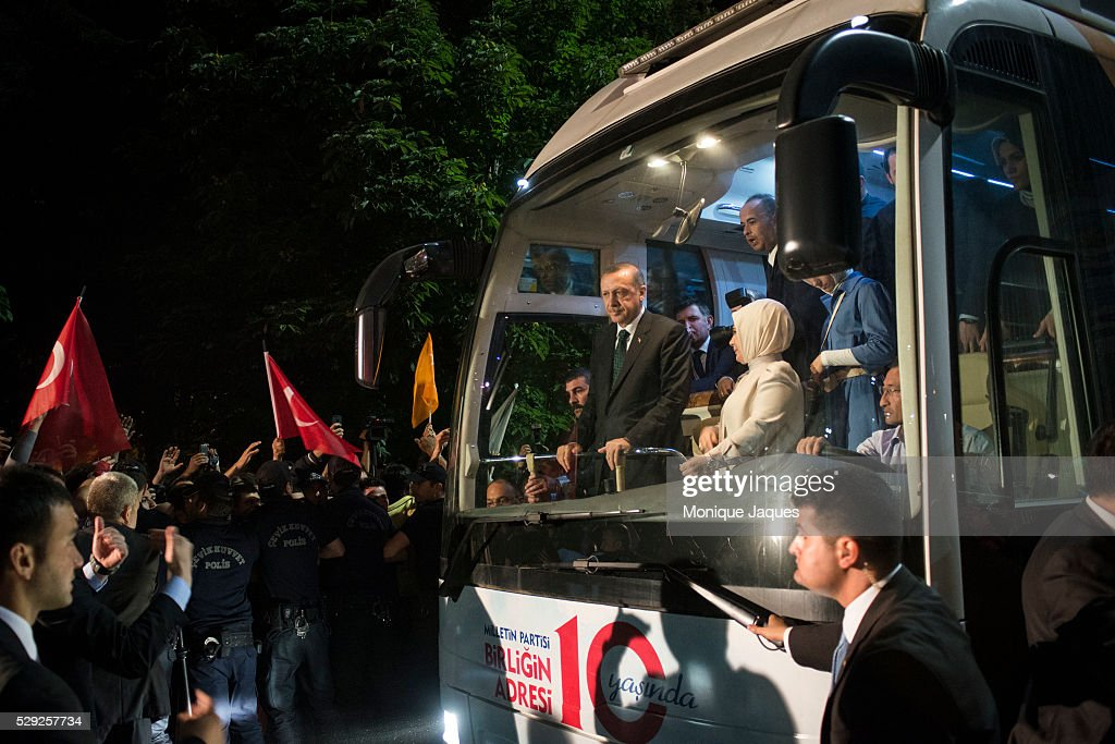 Prime Minister Erdogan and his wife Emine as they leave the airport AKP Supporters at Ataturk International Airport come out by the thousands to...