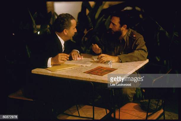 Prime Minister Fidel Castro and Swiss ambassador to Cuba Emil Stodelhofer negotiating free departure of Cubans who want to go to US at a latenight...