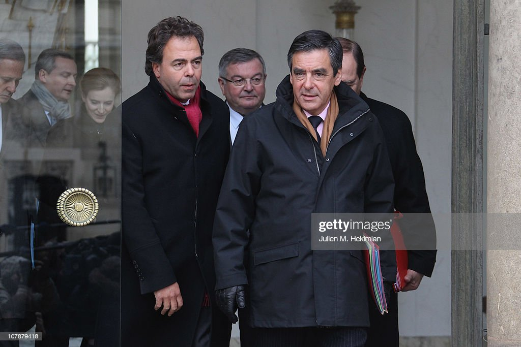 Prime Minister Francois Fillon (R) and Minister of National Education, Youth and Community Life <a gi-track='captionPersonalityLinkClicked' href=/galleries/search?phrase=Luc+Chatel&family=editorial&specificpeople=4292995 ng-click='$event.stopPropagation()'>Luc Chatel</a> leave the first weekly cabinet meeting of the new year on January 5, 2011 in Paris, France.