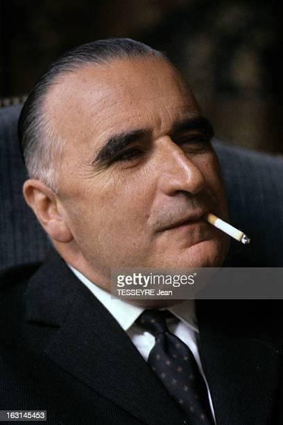 Prime Minister Georges Pompidou Portrait de Georges POMPIDOU en costume cravate assis dans un fauteuil fumant une cigarette