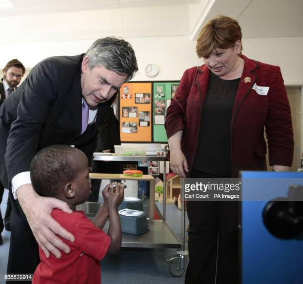 Prime Minister Gordon Brown and Emily Thornberry MP for Islington South and Finsbury talk to a young boy during a visit to the Golden Lane Children's...