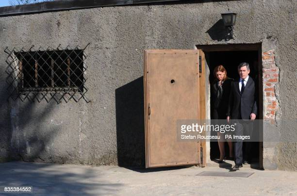 Prime Minister Gordon Brown and his wife Sarah Brown leave one of buildings where the gas chambers were situated at the Nazi concentration camp...