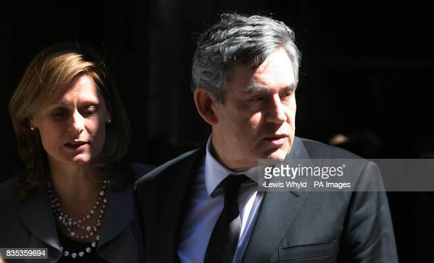 Prime Minister Gordon Brown and his wife Sarah Brown leave the funeral of Sir Clement Freud at St Bride's Church in Fleet Street London
