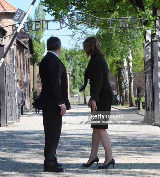 Prime Minister Gordon Brown and his wife Sarah Brown visit the Nazi concentration camp Auschwitz near Krakow in Poland today The sign over the...