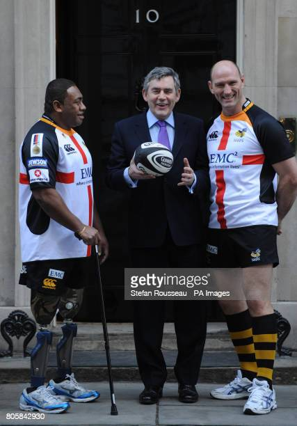 Prime Minister Gordon Brown and rugby player Lawrence Dallaglio with double amputee Derek Derenalagi on the doorstep of 10 Downing Street London The...