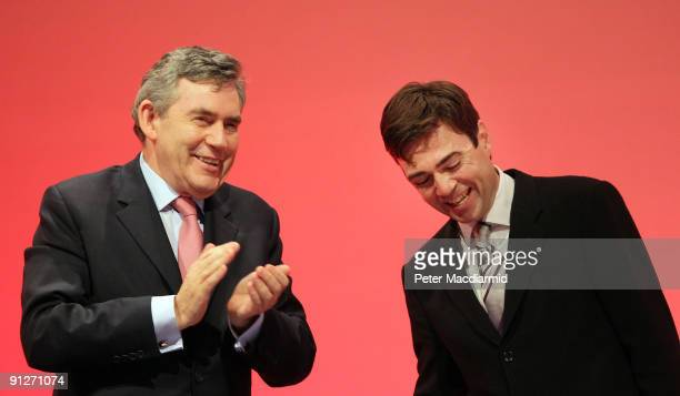 Prime Minister Gordon Brown applauds Secretary of State for health Andy Burnham at the Labour Party Conference on September 30 2009 in Brighton...