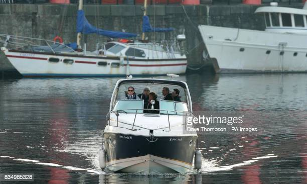 Prime Minister Gordon Brown arrives at the Albert Dock in Liverpool as he continues his threeday regional tour of the country