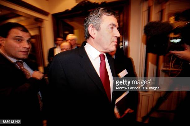Prime Minister Gordon Brown arrives with Lord Karan Bilimoria founder of Cobra Beers before he speaks at an event on global entrepreneurship linking...