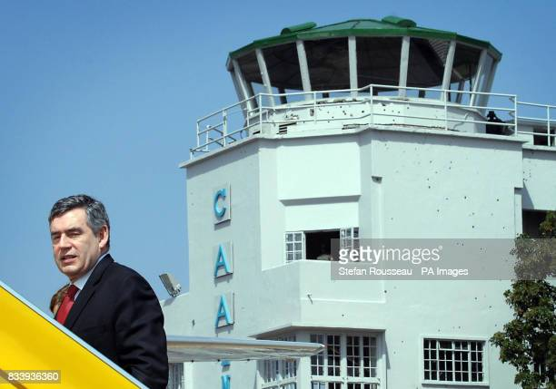 Prime Minister Gordon Brown boards his flight at Entebbe Airport in Uganda after attending the Commonweath Heads of Government Meeting