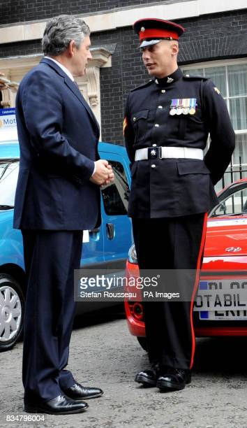 Prime Minister Gordon Brown gives Corporal Mark Sutcliffe from Peterborough who lost a leg in a terrorist attack whilst serving in Iraq the keys to...