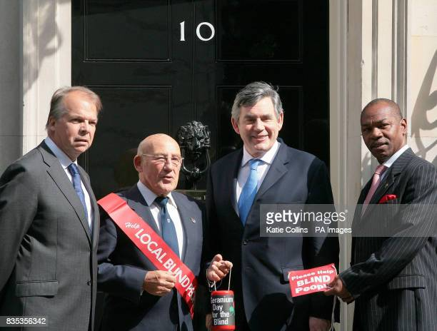 Prime Minister Gordon Brown is joined by Greater London Fund For The Blind Chairman David Hawkins Vice President of GLFB Sir Stirling Moss and GLFB...