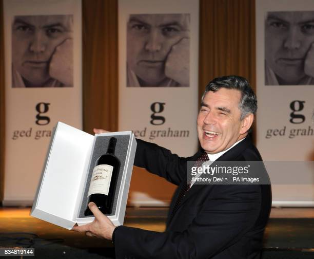 Prime Minister Gordon Brown is presented with a magnum of Brown's wine as he visits the Irish World Heritage Centre in Cheetham Hill following the...